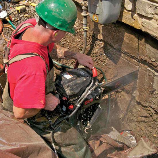 ICS 695XL-F4 Chain Saw Cutting Concrete