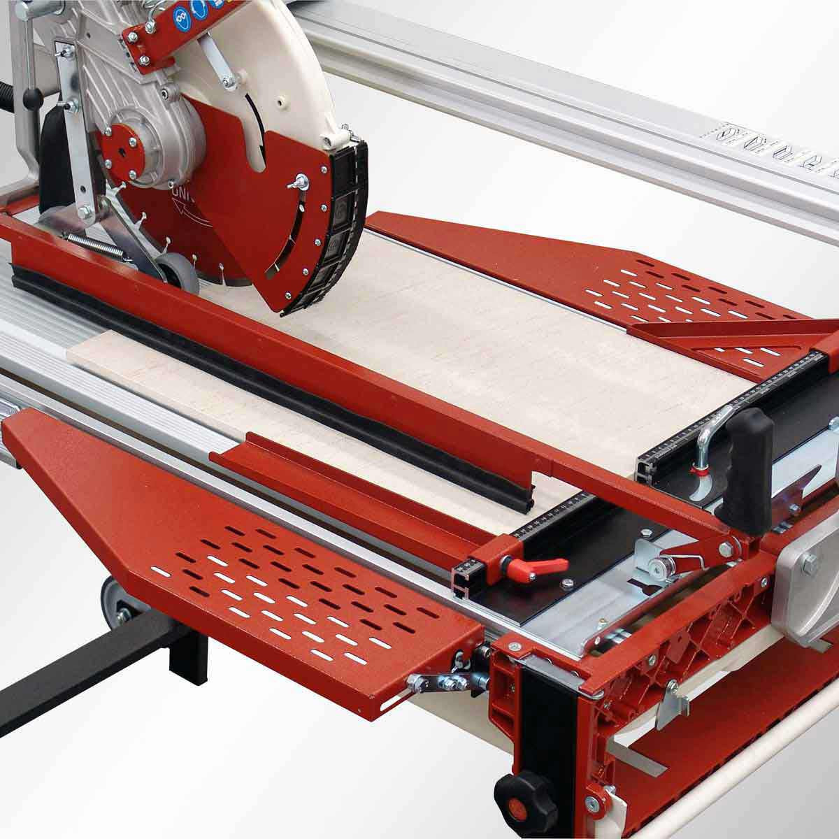 Large tile cutting with hold down guide on rail saw