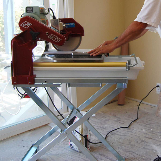 MK tile saw cutting indoors with water pan
