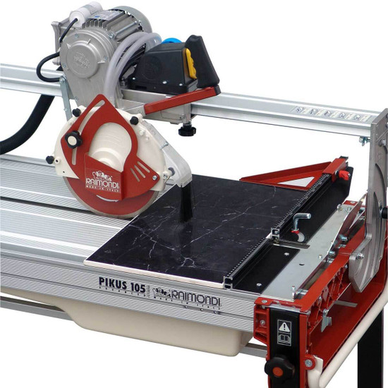 Raimondi Gladiator Advance Rail Saw cutting tile