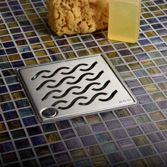 Quartz by Aco Shower Drains. Grates are provided with a lock down for additional security in public places