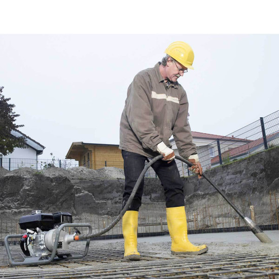 Wacker Neuson A5000 Concrete Vibrator in use on slab