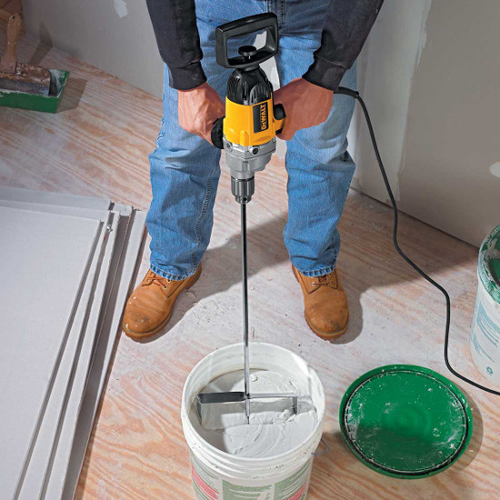 DW130V Dewalt 1/2 in. Mixing Drill mud beater mixing into bucket
