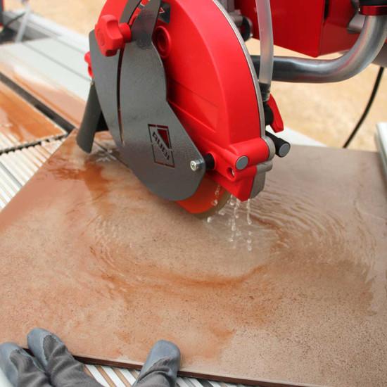 Rubi DX250-1000 Tile Saw wet cutting tile on a diagonal