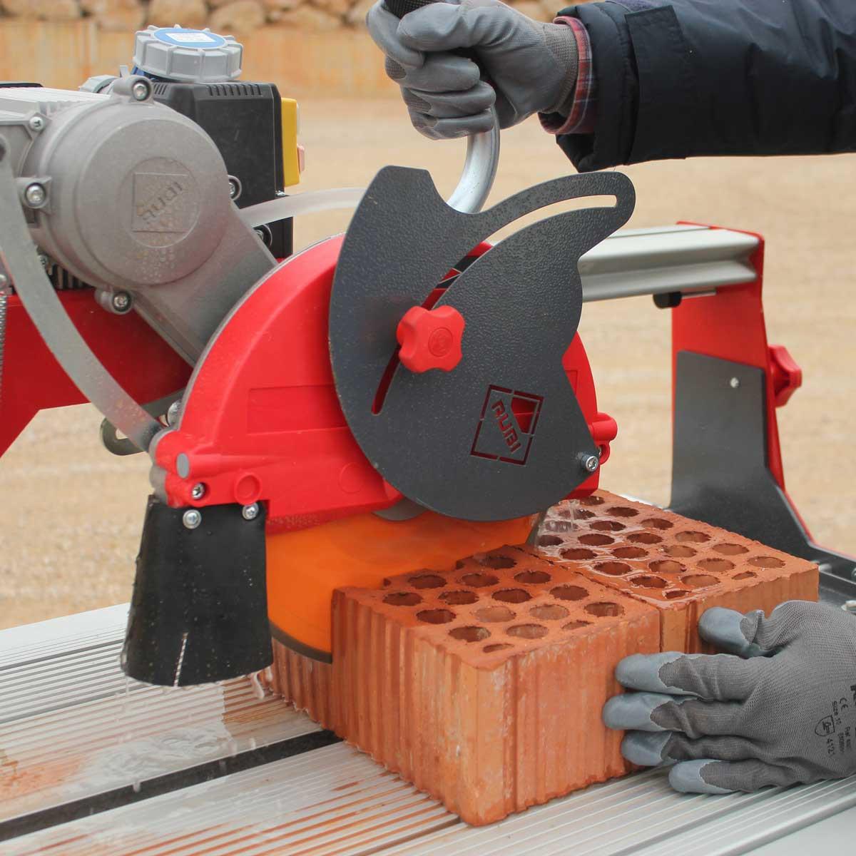Rubi rail saw cutting brick