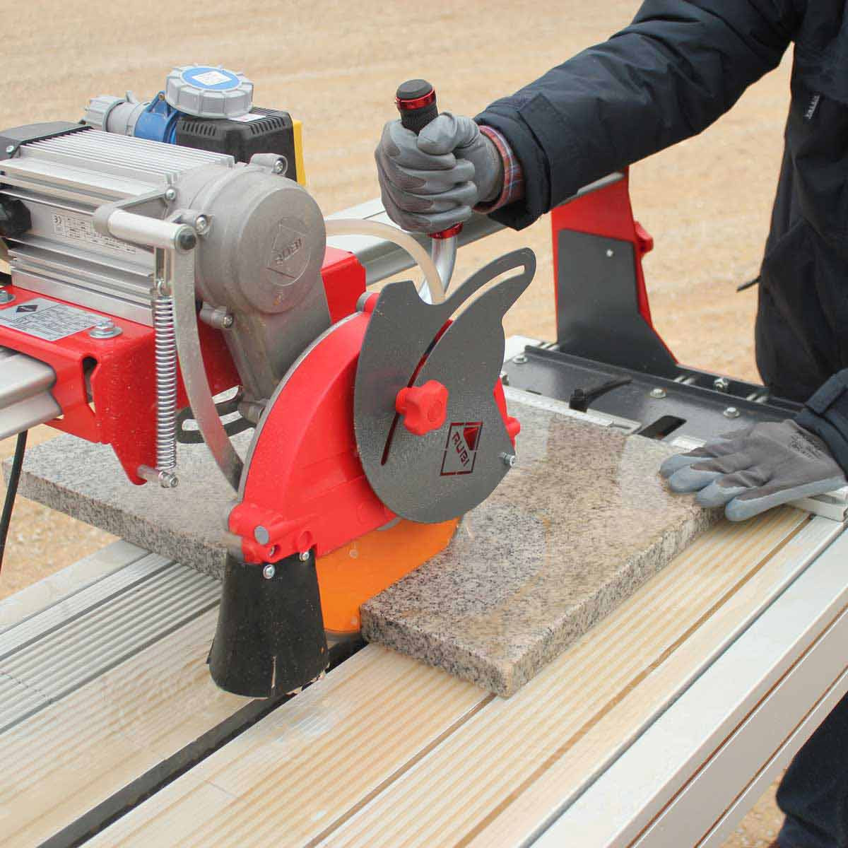 Rubi rail saw cutting granite countertops
