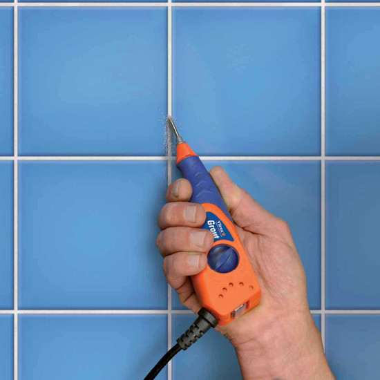 Vitrex grout out tool in use