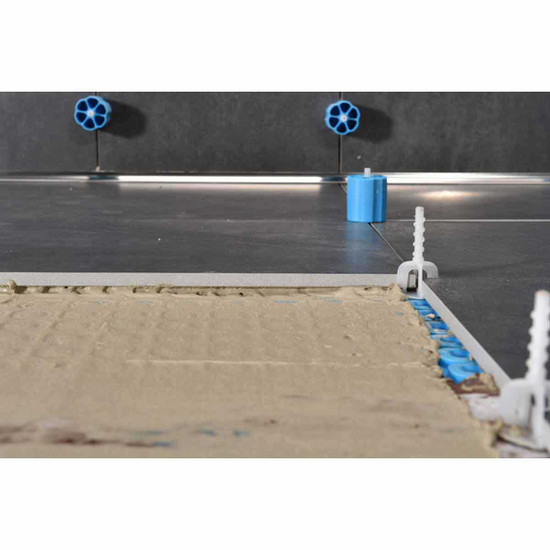 Prodeso Proleveling System caps and clips into mortar floor tile installation