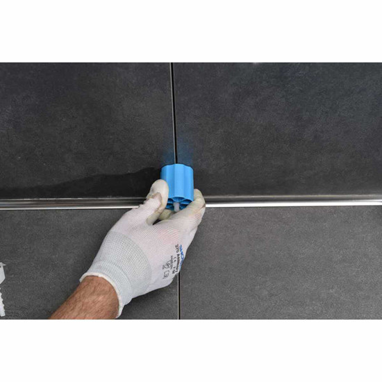 Prodeso Linear Leveler caps twist to tighten tile into place