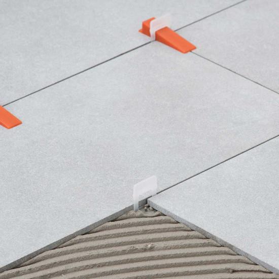 porcelain tile leveling clip into mortar glue floor tile