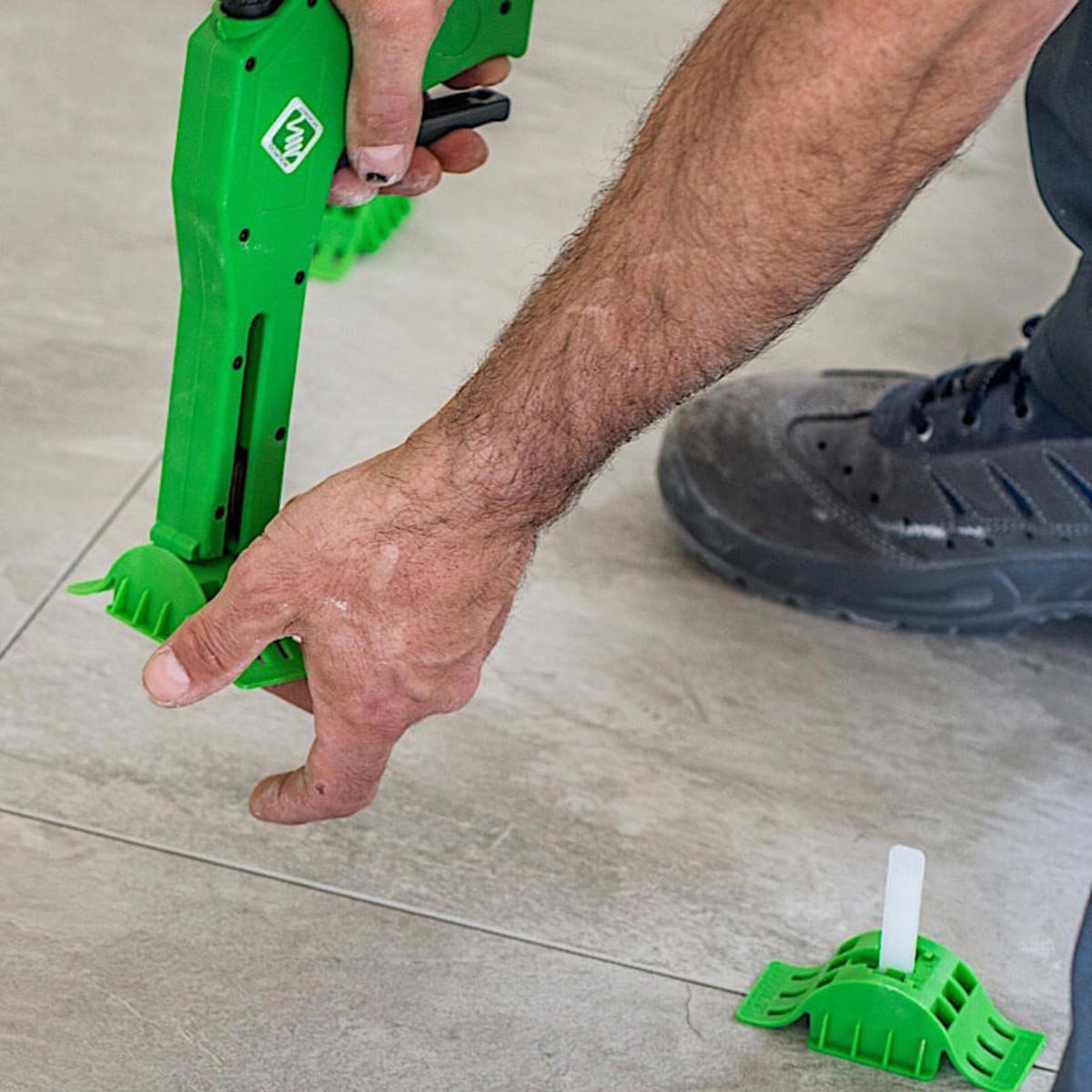 MLT gun removing caps floor tile