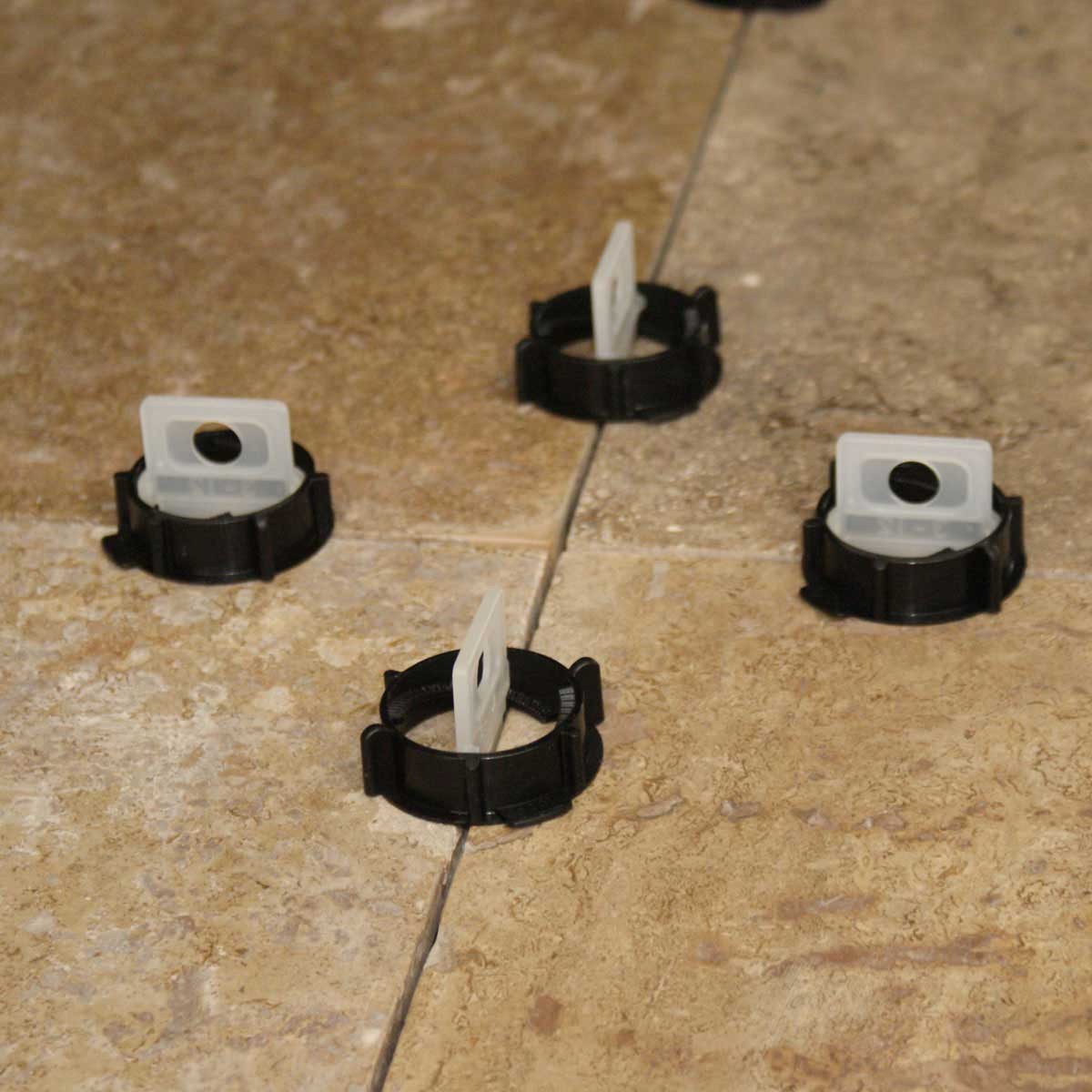 tornado leveling system between tile layout