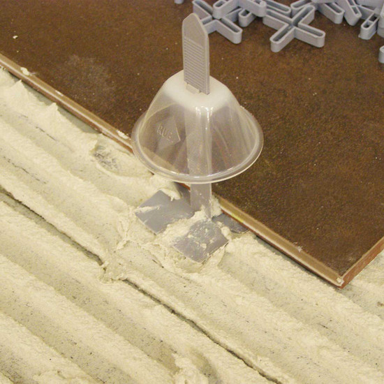 Ideal tile leveling system for laying large tile that are over 12 in. or that require the use of an adhesive mix