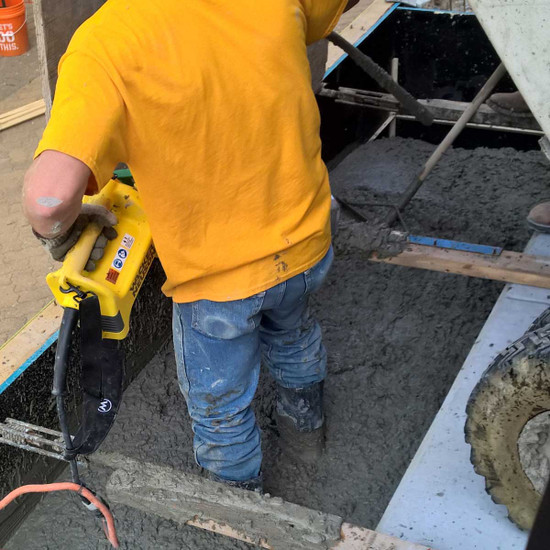 Wacker Neuson M1500 concrete vibrator in use