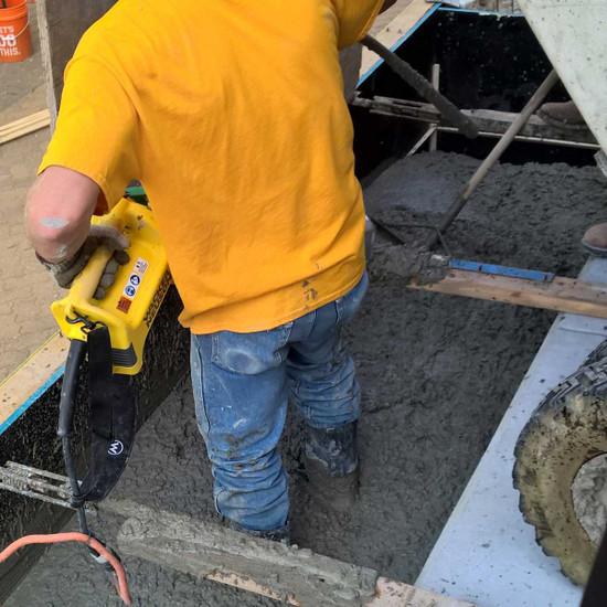 Wacker Neuson M1500 concrete vibrator in use