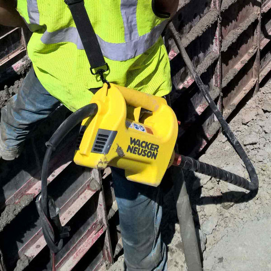 Wacker Neuson M1500 concrete vibrator in use on form