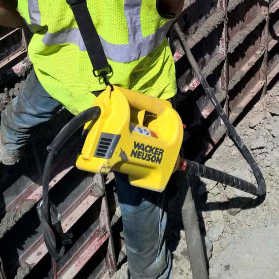 Wacker Neuson M1500 concrete vibrator in use on form