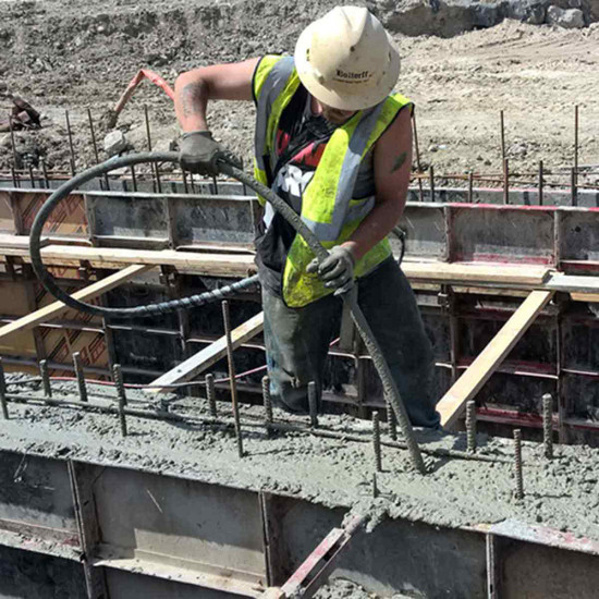 Wacker Neuson M1500 concrete vibrator in use on concrete form