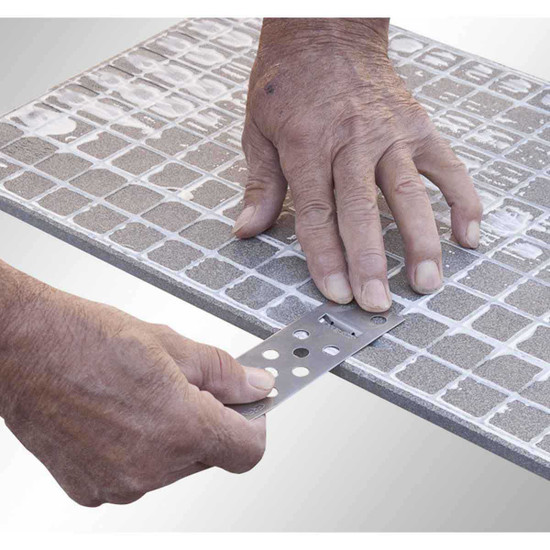 Indeed adhesives guarantee perfect anchorage of the tile slab only if perfectly applied. raimondi rai fix