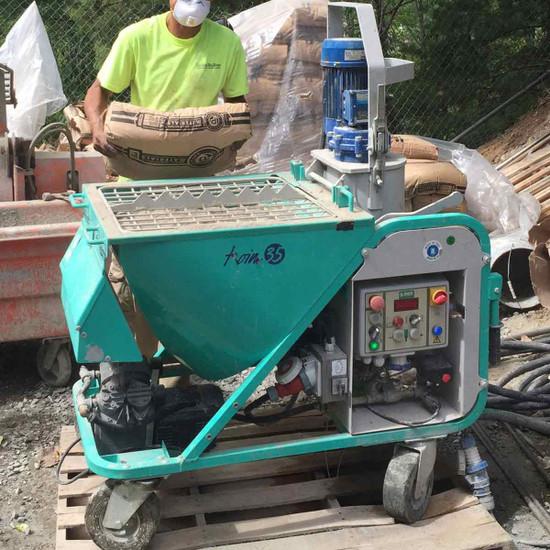 Loading Mortar into Koine 35 Hopper for Spraying