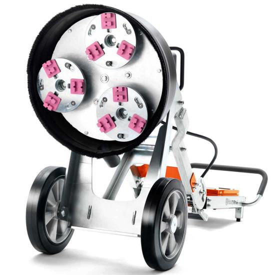 3 large rotating grinding wheels on Husqvarna PG 450