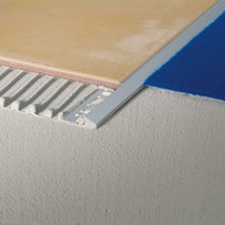 The Blanke Reducer Trim is specifically designed to transition from ceramic tile and stone down to vinyl or other thin floor surfaces.