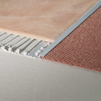 Blanke Aluminum Carpet Trim Tile Transitions is an ideal transition from hard tile to carpet. The gradual sloped nose of the profile covers the edge of the carpet and prevents unsightly fraying