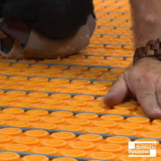 Laying Schluter DITRA-HEAT Membrane