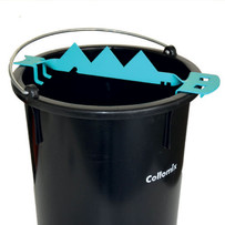 Collomix Sharky Bag Ripper, 19190, fits onto your mixing bucket, then place material bag on the teeth and the bag will open and fill up the bucket with ease