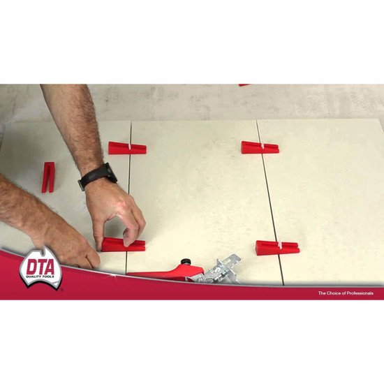 DTA Wedge Lippage floor leveling straps in mortar