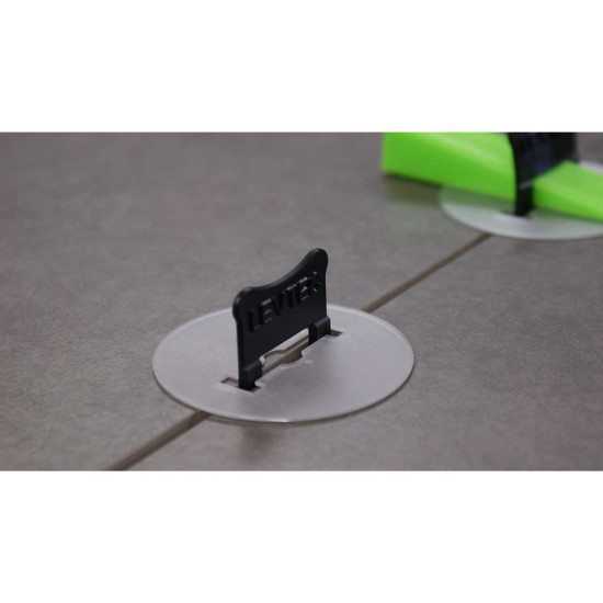 eliminate friction between the tile by converting lateral force into vertical pressure