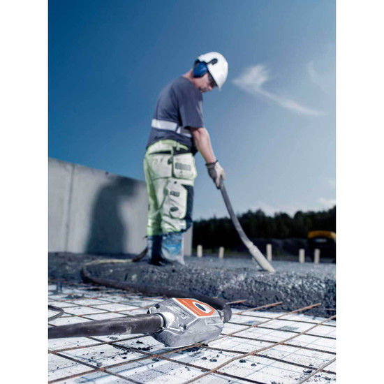 Husqvarna smart concrete vibrator in use on slab