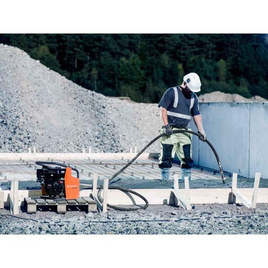 Husqvarna AMG 3200 Concrete Vibrator in use on concrete slab