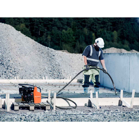 Husqvarna AMG 3200 concrete vibrator in use on slab