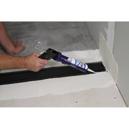 Applying Sealant to Goof Proof Linear Shower Drain