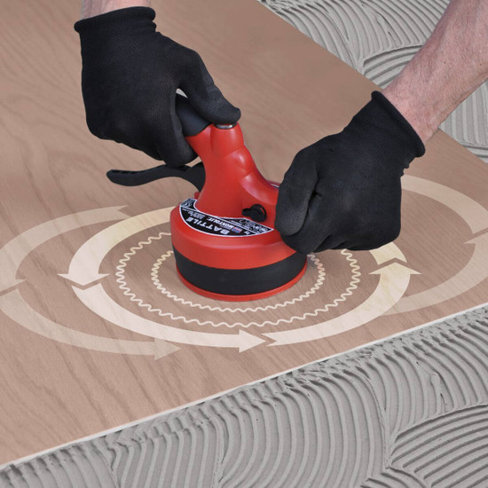 Vibrating Large Format Tile into Thinset Adhesive