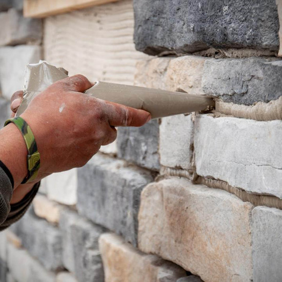 Applying Mortar to Brick Wall with ProGrade Disposable Bags