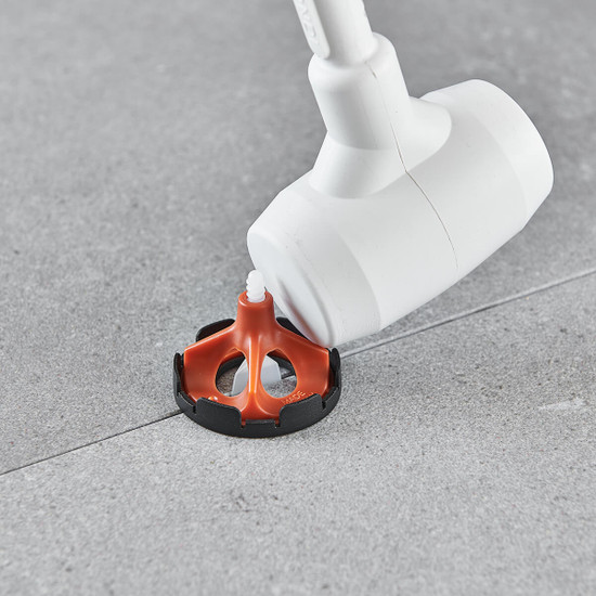 Removing Vite Leveling System with Rubber Mallet