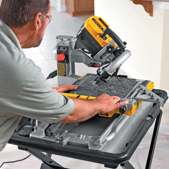 Dewalt D24000 Tile Saw cutting tile with 45 degree miter cut