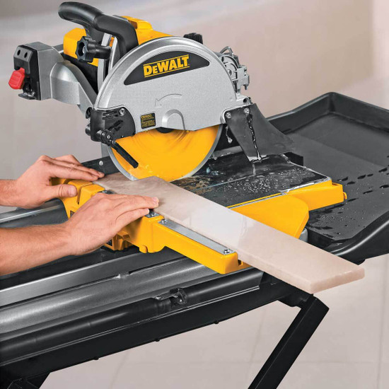 Dewalt Tile Saw cutting tile with extension table