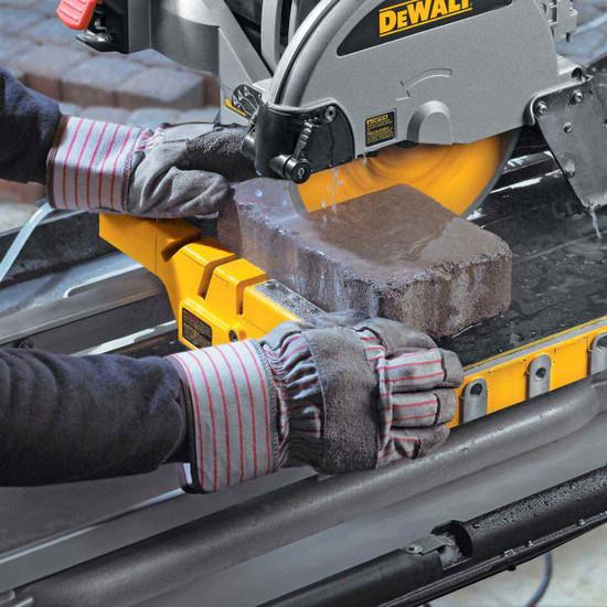 Dewalt D24000 Tile Saw cutting pavers
