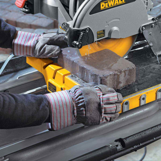 Dewalt D24000 Tile Saw cutting pavers