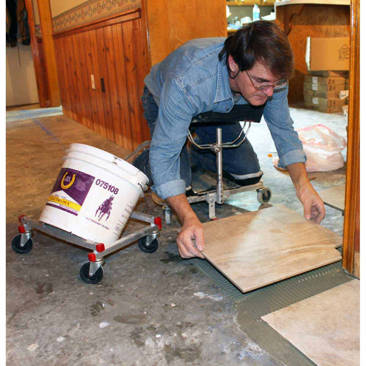 laying tile RAC-A-TAC chest support