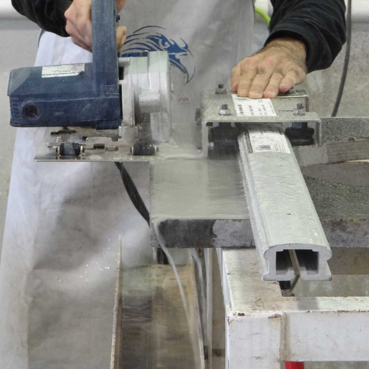 Wet cutting with carriage assembly and rail
